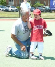 Volunteers and participants in the Spring Miracle League season gather