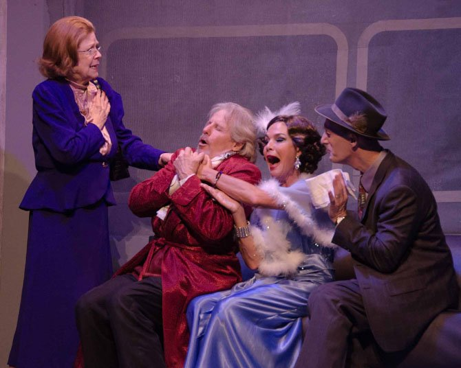 "Kathy Fannon (Ida Webb), David James (Oscar Jaffe), Margaret Bush (Lily Garland), and James McDaniel (Owen O'Malley) in The Little Theatre of Alexandria's production of ""Twentieth Century,"" running through June 29."
