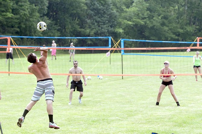The Side-Out Foundation held its annual Rock the Pink grass doubles volleyball tournament at the Occoquan Regional Park with hundreds of players participating in the fundraising event. The goal was to raise $50,000 for breast cancer research.