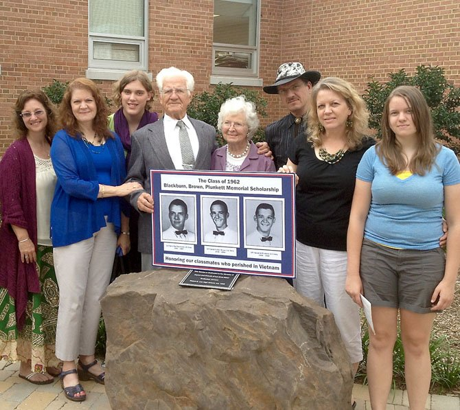 From left, Janis Blackburn, Cora Blackburn-Girard, Suzy Blackburn, Denney Blackburn, Lorraine Blackburn, Daniel Blackburn, Jenny Blackburn-Bowman and Cassidy Bowman. The Blackburn family all came together to attend the ceremony and see David Blackburn be honored by Robert E. Lee High School.