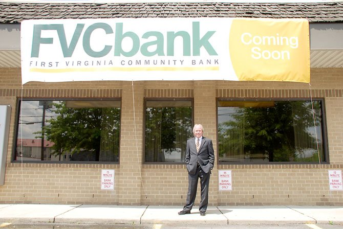 """Mr. Springfield"" Todd Lattimer stands in front of the newest branch of First Virginia Community Bank."