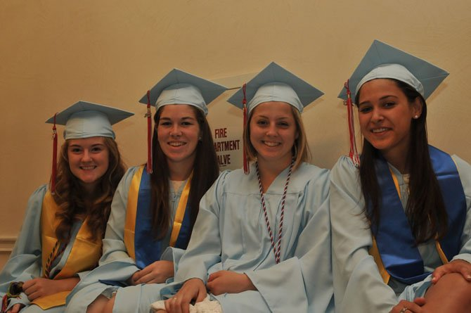 Rebecca Toser, Ashley Asta, Katherine Clark and Alexandra Sandlin celebrate Marshall High School's graduation Friday, June 14.