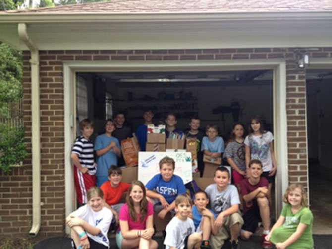 Oakton Elementary students who participated in a book drive in memory of Oakton dad Sergio Visaggio.