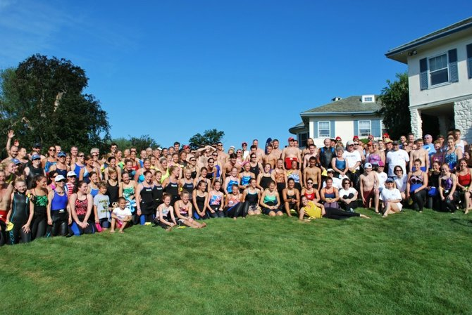 Swimmers at a Swim Across America event. Great Falls resident Paula Alford will swim in the Saturday, June 22, event in Stamford, Conn. to raise money for cancer research to defeat her brother's stage four, bile duct carcinoma.