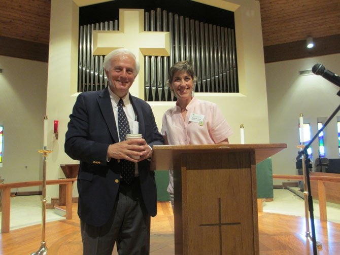 Bob Levey, whose career with the Washington Post spanned 37 years, and Shepherd's Center of Oakton-Vienna's Director Michelle Scott share the podium at SCOV's Lunch 'n' Life presentation on June 10 at Emmanuel Lutheran Church.