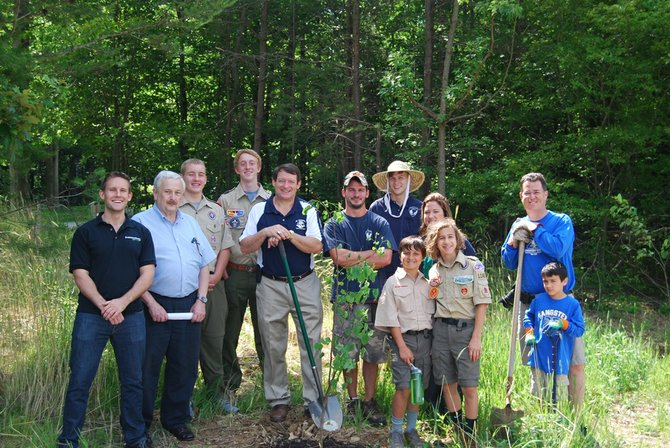Del. Dave Albo (R-42), Supervisor Pat Herrity (R-Springfield), scouts from Troop 1140, South Run Regency community members, Fairfax County Park Authority representatives and a 95 Express Lanes project representative stand near one of 10 trees installed at Burke Lake Park near the South Run Regency community.