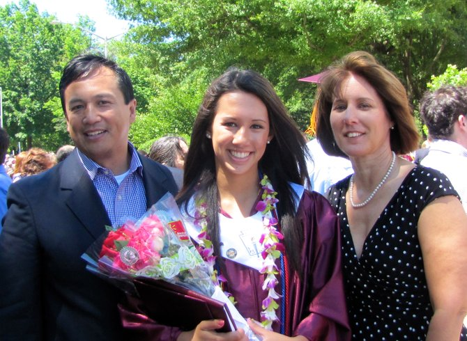 Allison Datoc stands with her family after the graduation ceremony.