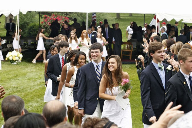 Members of the Class of 2013 are greeted by family and friends at the conclusion of the ceremony on June 8th.