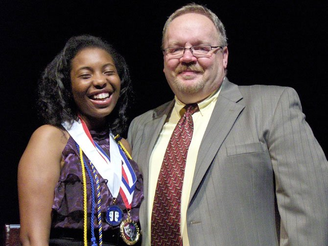 Binta Barry with Theater Director Mike Hudson. She received the Theater Department Thespian Medallion, was selected Best Actress and Comic Female. She also received a Drama Boosters Scholarship and will attend Longwood University.