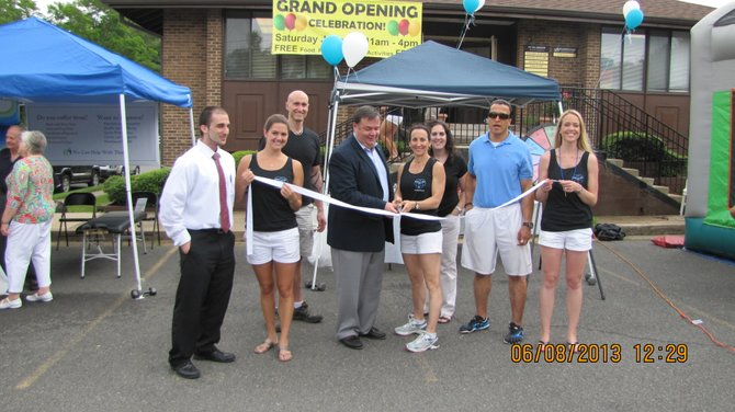 The ribbon cutting ceremony was attended by Mike Polychrones of the Vienna Town Council and the Vienna chapter of Moms Run This Town, a running group for local mothers and women.