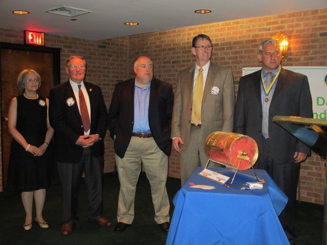 Vienna Rotarians Patricia Velkoff, George Creed, Jeff Bollettino, James Cudney and A. J. Oskuie were presented with the Paul Harris Fellow Awards for exceptional Rotary participation.