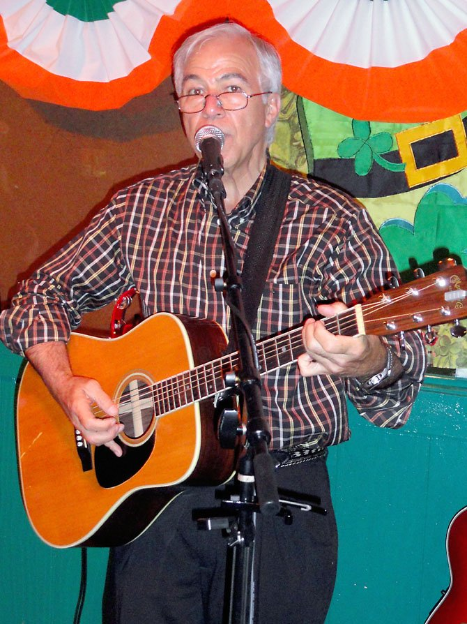 Jim Bellas, 65, performs on vocals and guitar at Kate's Irish Pub Open Mic Night in Springfield.