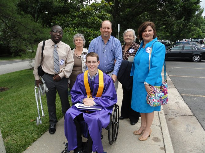 Nurse's aide Saint Kankam, grandmother Nadine Balenger, dad Steve Balenger, grandmother Rejane Quirion, and mom Sylvie Balenger with Nick Balenger (front row) after Lake Braddock's graduation ceremony at the GMU Patriot Center.