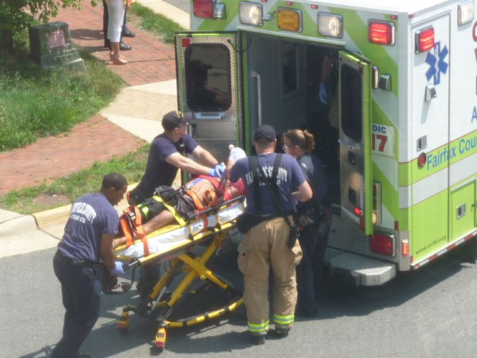 Station 17 paramedics prepare to place an injured man inside an ambulance.