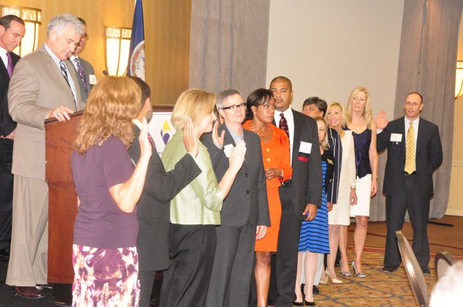 Del. Tom Rust (R-86) swears in the new board of the Greater Reston Chamber of Commerce Thursday, June 27.