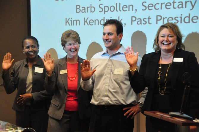 From left, Belinda LaValle, Barb Spollen, Mark Dolfis and Denise Miller are sworn in Tuesday, June 25 as the Fiscal Year 2014 board for Shelter House.