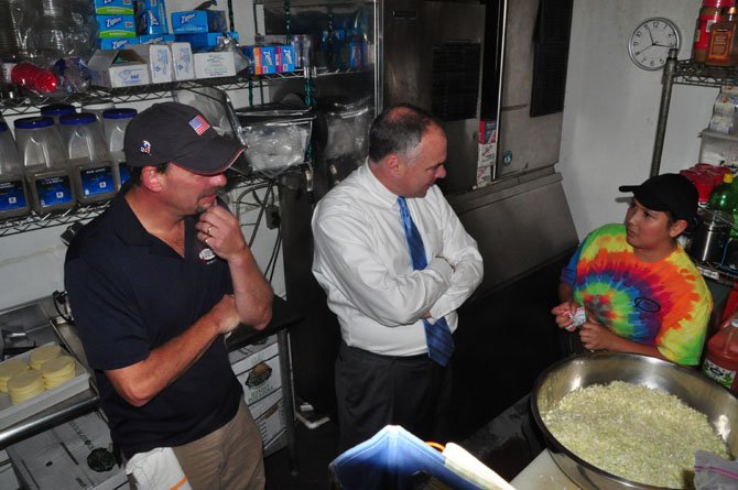 From left, Jimmy Cirrito, owner of Jimmy's Old Town Tavern, Sen. Tim Kaine (D) and Jimmy's staff member Flora Benivedes. Benivedes is a recent hire to Jimmy's, having recently been granted permission to work by the DREAM Act.
