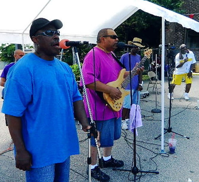 """Ain't no love like my Savior's love"" harmonize Crowns of Life vocalists Leevere Peoples (left), the Rev. Steve Brown, Nate Bolds (in hat) and Ezekiel Raspberry Sr. Andrea Walker plays drums and (not pictured) Kenny Lockard performs lead guitar."