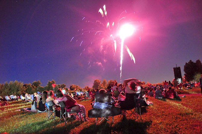 Visitors to Turner Farm watch the annual Fourth of July Fireworks show.