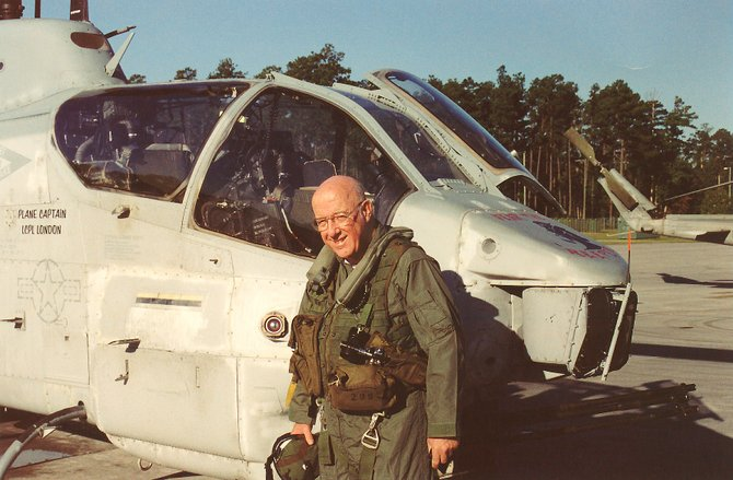 Robert F. Dorr after a flight in a Marine Corps AH-1W Super Cobra attack helicopter at Marine Corps Air Station, Little River, N.C.