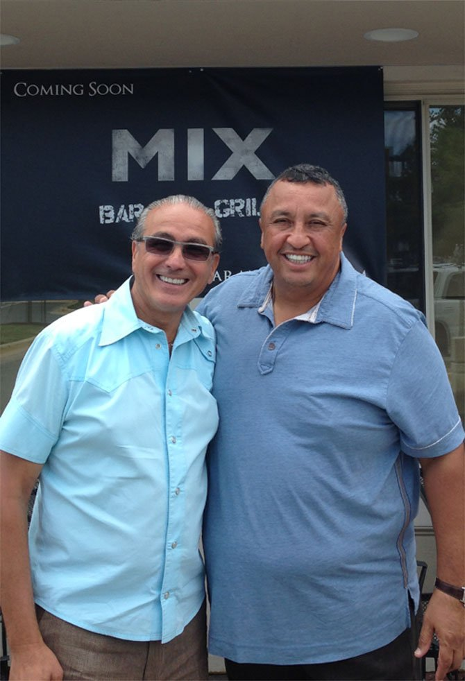 Eddie Benaim (left) with his partner Ramiro Paez.