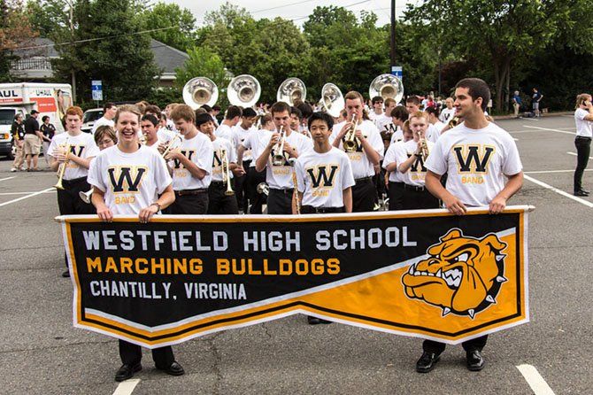 Morgan Tweddle (left) and Andrew Banick lead Westfield High's Marching Band at the City of Fairfax Fourth of July Parade.