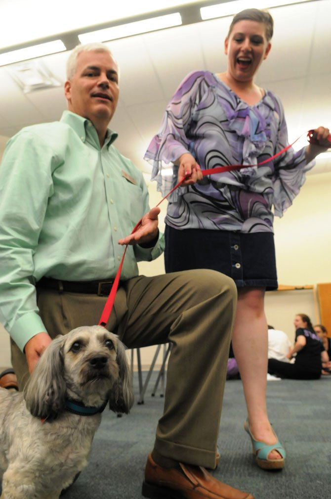 Bubbles the dog stars as Rufus along with Jim Clancy as UPS driver Kyle O'Boyle and Meghan Smith as Paulette the manicurist in the Encore Stage and Theatre production of 'Legally Blond.'