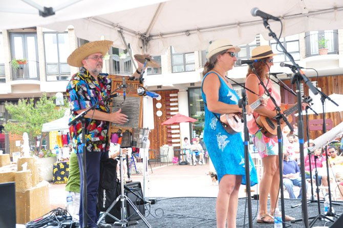 Pat Quinn, Gina DeSimone and Ron Goad perform at Lake Anne during the Northern Virginia Ukulele Festival Saturday, July 13.