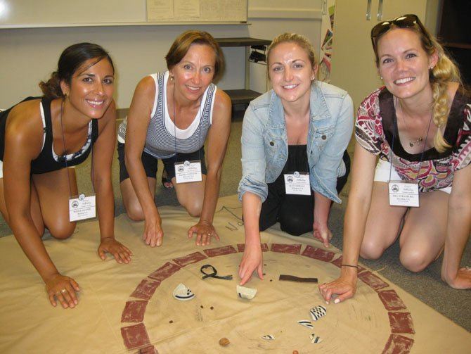Teachers from Reston-Herndon area participating in a simulated archeological dig as a part of the Discovering the Past Session: From left—Poneh Aranee, Karen Stevens, Kat Goodale and Meg Strasburg.