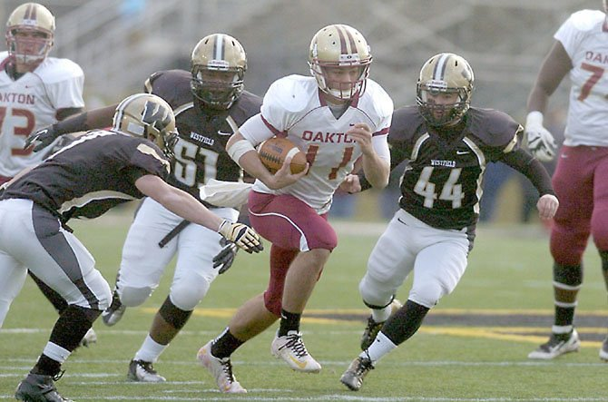 Kyle Downer (11), a 2013 Oakton High School graduate, will play football at the University at Albany.