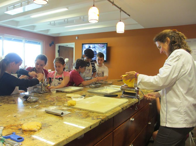 Culinaria campers take instruction from Chef Marilena Leavitt, classical chef.