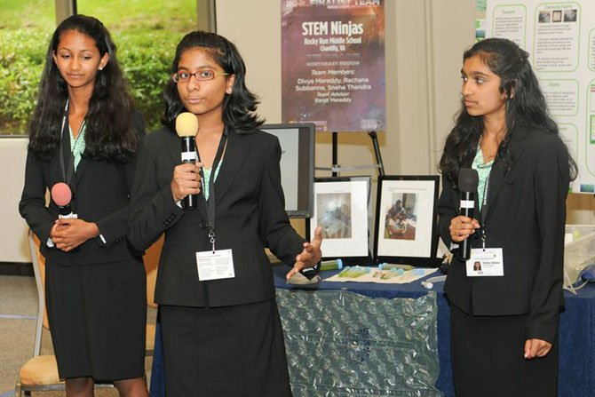 Team STEM Ninjas (from left) Sneha Thandra, Divya Mereddy and  Rachana Subbanna present their project at the national competition.
