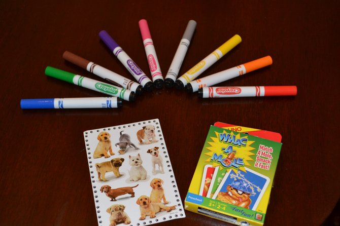 When packaged creatively, flashcards, stickers, paper and crayons can entertain children during long trips.