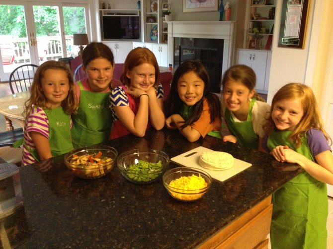 From left: Katie King, Sasha Fedorchak, Lucy Rogers, Eliza Grace Ulmer, Haley King and Grace Griffin prepare to cook in Arlington, Va. Local culinary enthusiasts say there are an abundance of healthy summer treats that can be made at home.