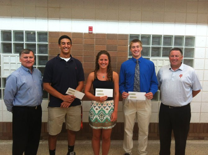 Fort Hunt Youth Athletic Association President Bob Burton with Jackson Casey Scholarship winners Alex Houser, Mary Patalita, John Schlesinger and Sean Casey. (Not pictured, Toni Stapleton.)