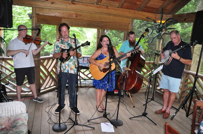 Members of the Rogue Farmers perform at a fundraiser for the McLean Orchestra Sunday, July 21.