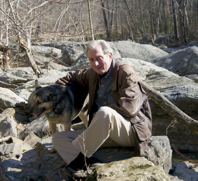 "Great Falls resident John Dibble and his dog Noochie. Dibble has written his first novel, ""Difficult Run,"" which is set in Great Falls Park."