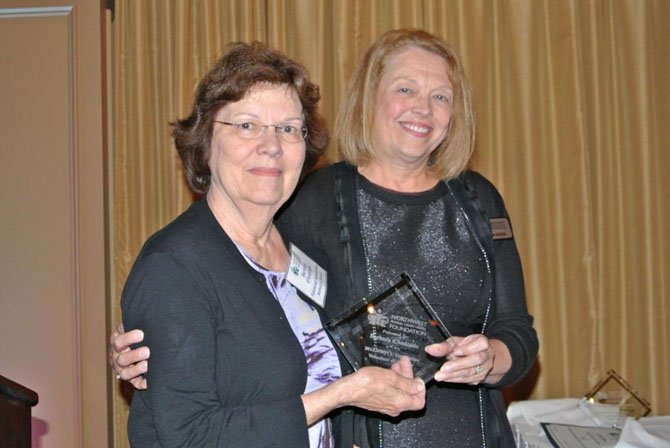 Linda Rogus, executive director of NWFCU Foundation (right), presents Barbara d'Andrade with the 2013 Volunteer of the Year award. D'Andrade lives in Vienna and has been an active foundation volunteer for several years.