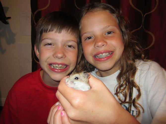 Rose and Gloria Boos with Chip the hamster (the lone survivor). Both girls are 9 years old, attend Great Falls Elementary School and are rising fourth graders.