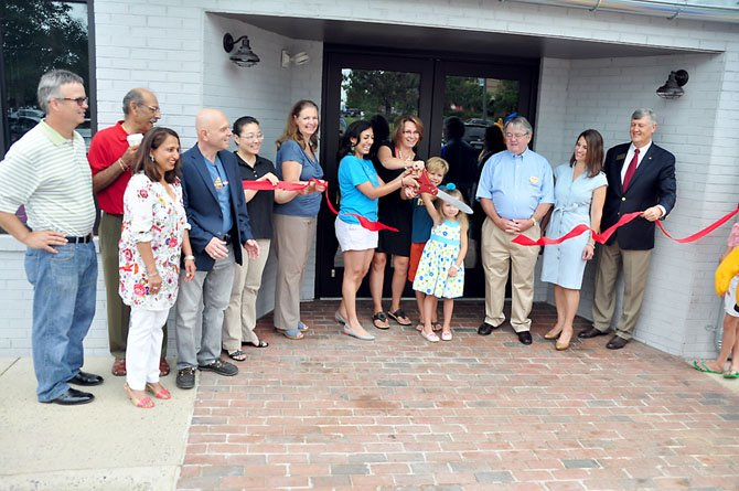 Herndon officials and members of the business community cut the ribbon on the Mellow Mushroom Monday, July 22.