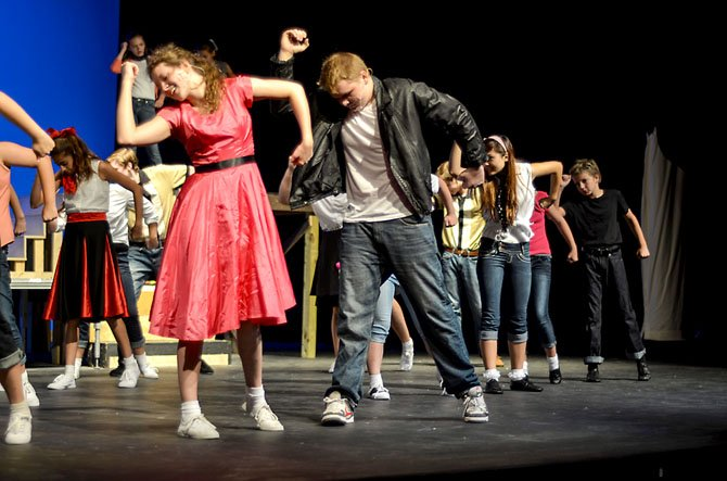 "Sarah Overton and Nathan Hawn (center) in the production of ""Bye Bye Birdie."""