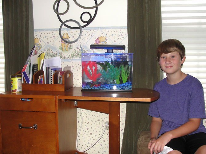 Carson Stewart poses with his fish tank.