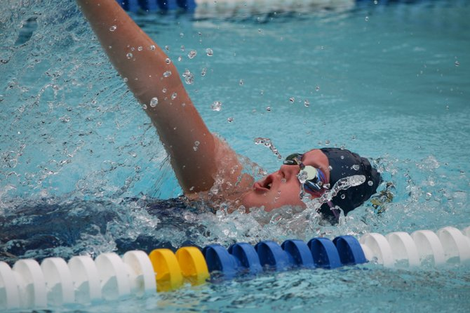 The Shouse Village Sharks' Fiona Williams swimming in the girls 9-10 50 Meter Backstroke.