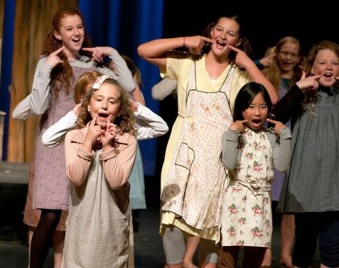 "From left—Megan Steele, Gwendolyn Evans, Marin Bronaugh, Amy Chang and Paige Cole played orphans in City of Fairfax Theater Company's sold-out production of ""Annie"" this weekend at Lanier Middle School."
