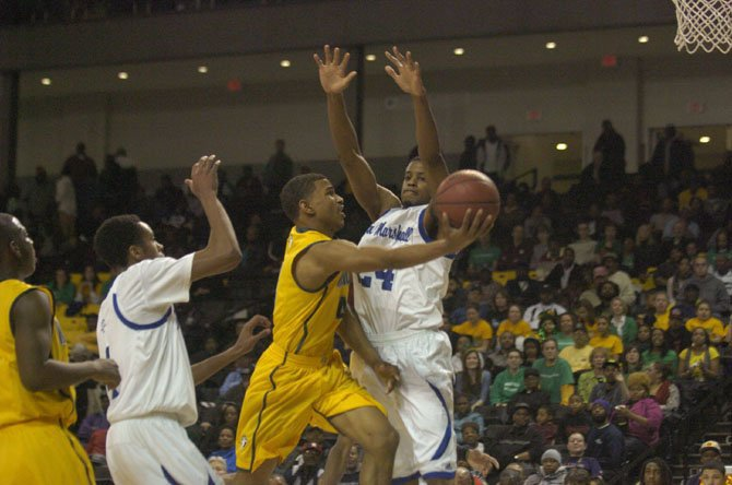Khory Moore, with ball, helped the Wakefield boys' basketball team reach the state semifinals in 2013.
