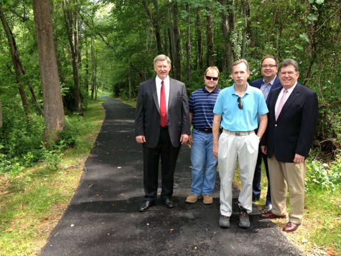 From left, Supervisor John Foust (D-Dranesville), Bill Boston, Fairfax County Park Authority project manager, Kirk Holley, park authority manager with the Special Projects Branch, Planning and Development Division, David Bowden, director of the park authority's Planning and Development Division; and Dranesville District representative to the Fairfax County Park Authority Board Kevin Fay at a newly-completed extension of trail that connections Churchill Road to Ingleside Avenue.
