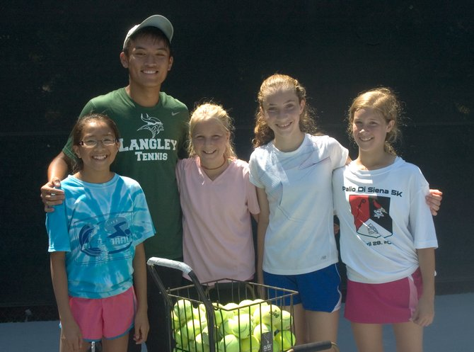 (From left): Julia Bullock, assistant coach Andrew Hwang, Emmy Mohler (homeschooled, age 12), Maria Baird and Callie Goodwin (Ambleside School, age 12) have all enjoyed summer lessons at Great Falls Swim and Tennis.