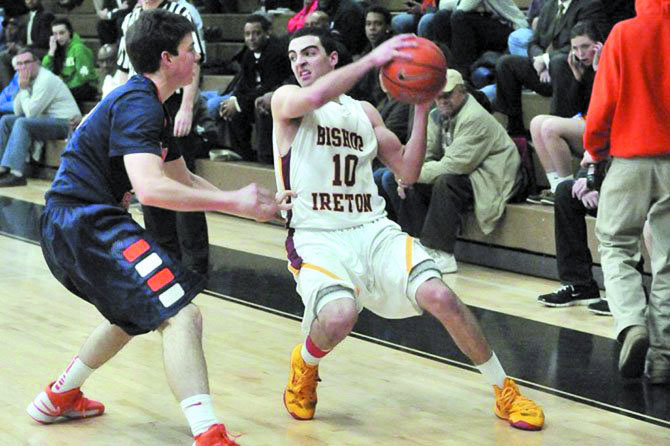 Bishop Ireton graduate Louis Khouri, with ball, will play basketball at Catholic University of America.