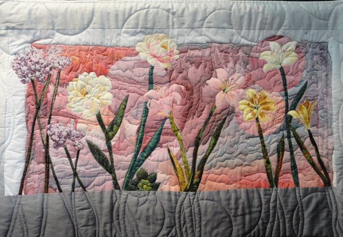 Expressing joy, Linda T. Cooper of Burke created this quilt depicting blooming flowers.