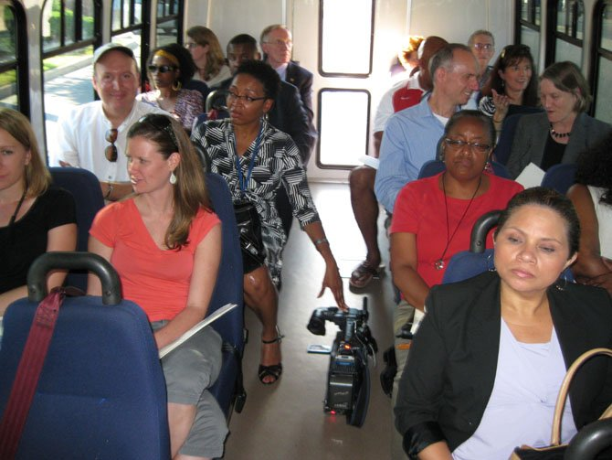 Members of the media and invited guests take a bus tour of the Mount Vernon Pyramid neighborhoods.